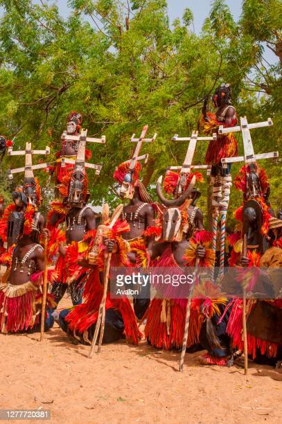 Dogon people in traditional dance costumes in the village of Sangha in the Dogon country in Mali, West Africa.