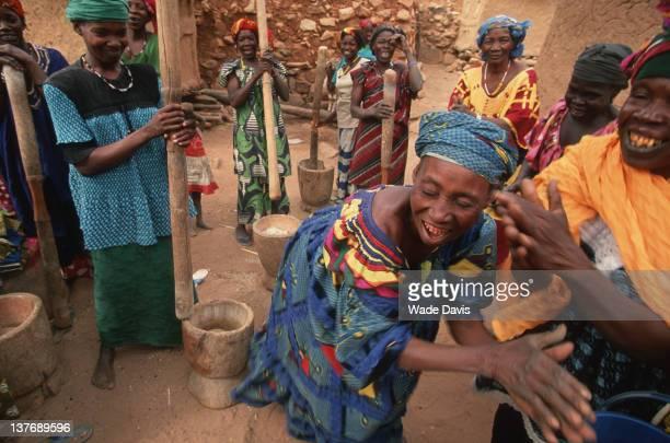 Dogon women pouding grain Bandiagara Escarpment Mali 2002