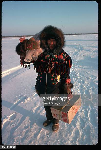 Dogrib Man Carrying Meat