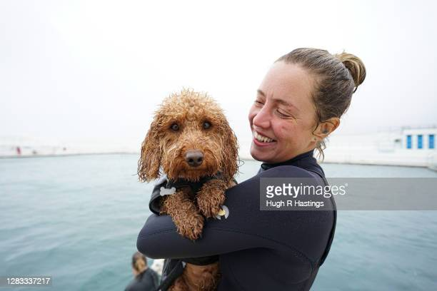 Dogs and their owners enjoy a pre-Lockdown swim at Jubilee Lido on November 1st, 2020 in Penzance, England. On the last day of its operating season,...