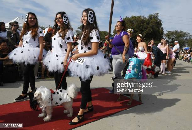 Dogs and their owners parade at the annual Haute Dog Howl'oween parade in Long Beach California on October 28 2018