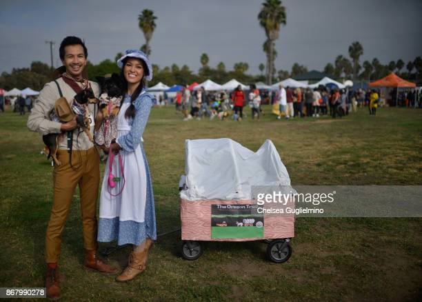 Dogs Olive and Caper dressed as the Oregon Trail attend Haute Dog Howl'oween Parade on October 29 2017 in Long Beach California