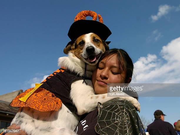 DOGS28Cassie Crown age 20 from Greenwood Village holds her dog named 'Shelbe Boo' during the Halloween costume contest for dogs on the last day of...