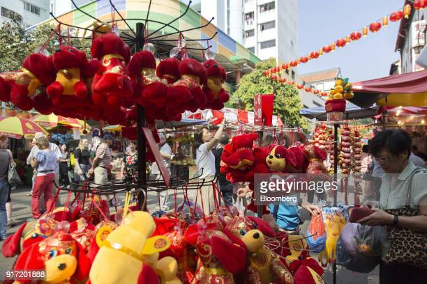 Dogthemed stuffed toys are displayed for sale ahead of the Lunar New Year at a street market stall in Chinatown Singapore on Saturday Feb 10 2018...
