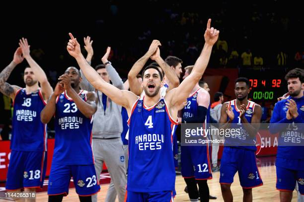 Dogus Balbay #4 of Anadolu Efes Istanbul and his teammate celebrates at the end of 2019 Turkish Airlines EuroLeague Final Four Semifinal A game...