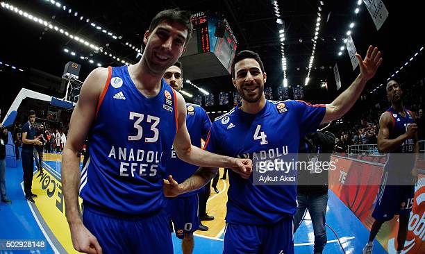 Dogus Balbay #4 of Anadolu Efes Istanbul and Jon Diebler #33 of Anadolu Efes Istanbul celebrate victory during the Turkish Airlines Euroleague...