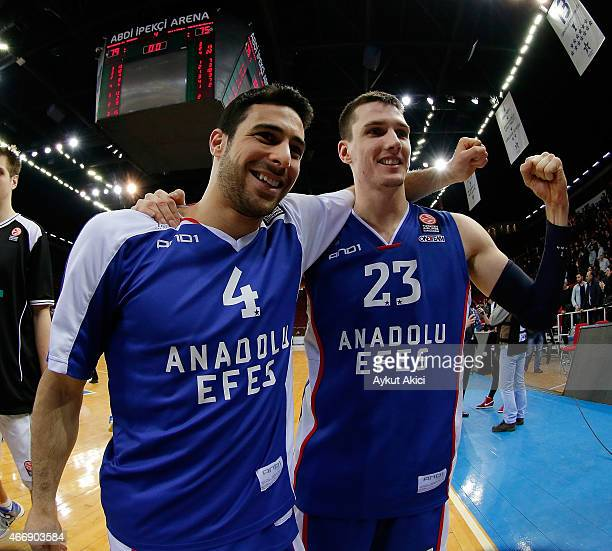 Dogus Balbay #4 of Anadolu Efes Istanbul and Matthew Janning #23 of Anadolu Efes Istanbul celebrate victory during the Turkish Airlines Euroleague...