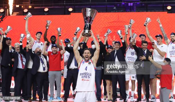 Dogus Balbay of Anadolu Efes holds up the trophy as he celebrates with his team after the Basketball Euroleague Final Four championship final match...