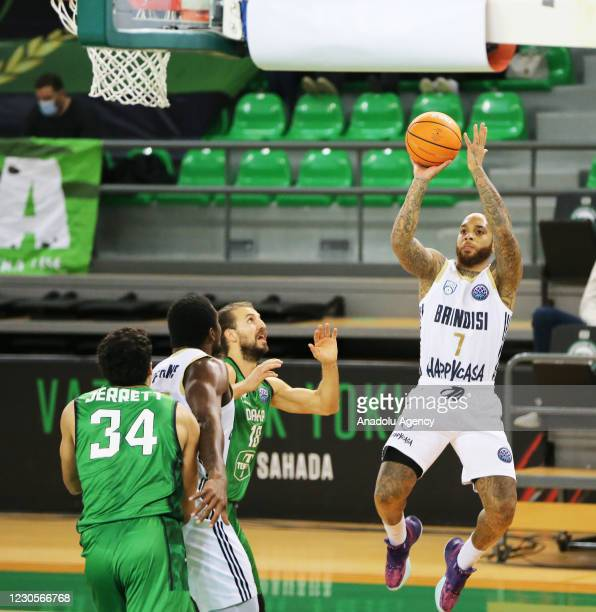 Dogus Ozdemiroglu of Darussafaka Tekfen in action against D'Angelo Harrison of Happy Casa Brindisi during FIBA Champions League Group H basketball...