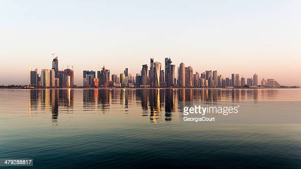 doha city qatar at sunrise - doha stockfoto's en -beelden