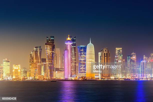 doha city skyline illuminating the night in qatar - doha stock pictures, royalty-free photos & images