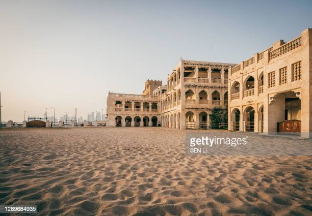 doha city street with traditional islamic architecture buildings - doha stock pictures, royalty-free photos & images