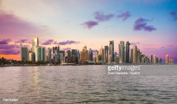 doha cityscape at sunset - doha stockfoto's en -beelden