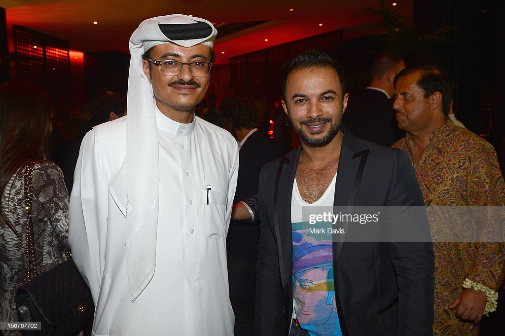 Doha Film Institute CEO Abdulaziz Bin Khalid Al-Khater (L) and Mohammed Harib attend the Bollywood Party at the W Hotel during the 2012 Doha Tribeca Film Festival on November 20, 2012 in Doha, Qatar.