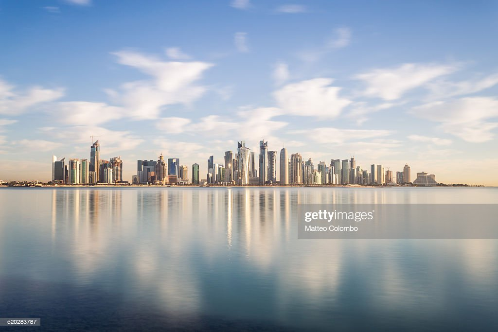 Doha modern city reflected in the sea, Qatar : Stock Photo