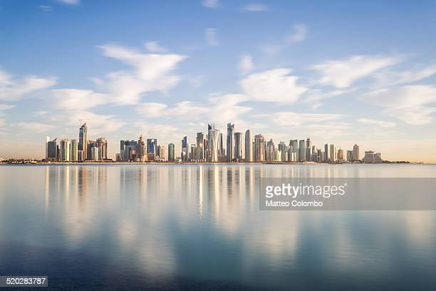 doha modern city reflected in the sea, qatar - orizzonte urbano foto e immagini stock