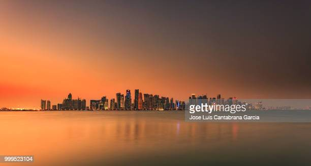 doha on fire! - qatar stock pictures, royalty-free photos & images