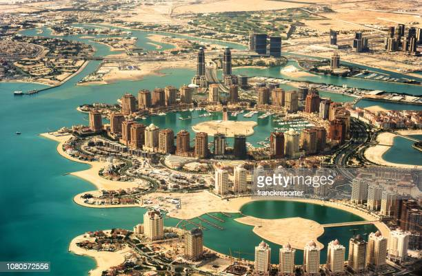 doha pearl aerial view - doha stock pictures, royalty-free photos & images