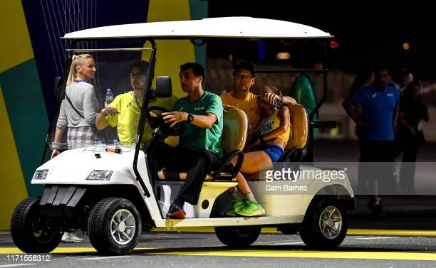 Doha , Qatar - 27 September 2019; Cecilia Norrbom of Sweden is taken for medical treatment after competing in the Women's Marathon during day one of...