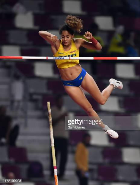 Doha , Qatar - 29 September 2019; Angelica Bengtsson of Sweden makes a clearance of 4.80m after borrowing a pole vaulting pole from Ninon...