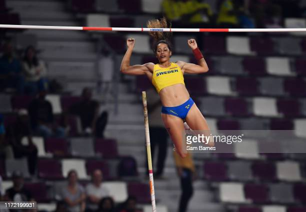 Doha Qatar 29 September 2019 Angelica Bengtsson of Sweden makes a clearance of 480m after borrowing a pole vaulting pole from Ninon GuillonRomarin of...
