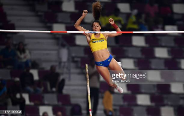 Doha , Qatar - 29 September 2019; Angelica Bengtsson of Sweden makes a clearance after borrowing a pole vaulting pole from Ninon Guillon-Romarin of...
