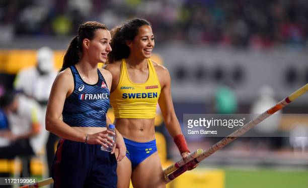 Doha , Qatar - 29 September 2019; Angelica Bengtsson of Sweden, right, after clearing 4.80m using a pole vaulting pole borrowed from Ninon...