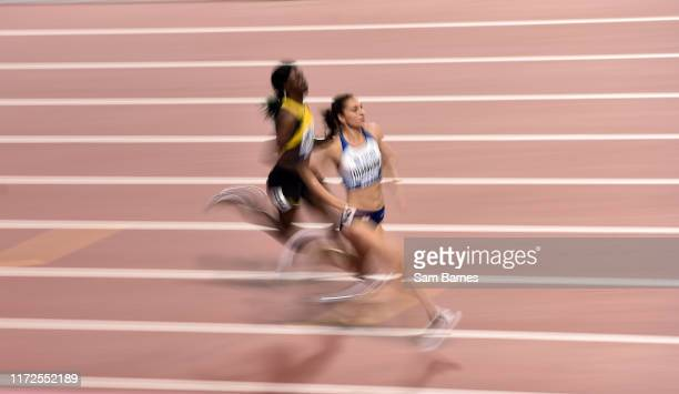 Doha Qatar 30 September 2019 Emily Diamond of Great Britain right and Shericka Jackson of Jamaica competing in the Women's 400m Heats during day four...