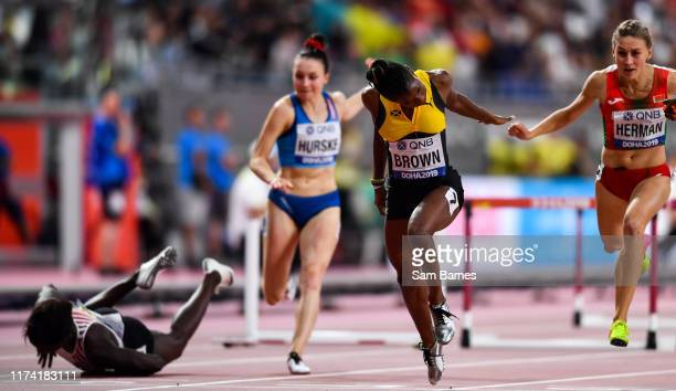 Doha Qatar 6 October 2019 Janeek Brown of Jamaica second from right dips for the line as Anne Zagre of Belgium far left falls whilst competing in...