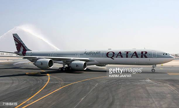 New Qatar Airways Airbus A340-600 sits on the tarmac at Doha airport after arriving from Airbus headquarters in Tolouse, 11 September 2006. Qatar...