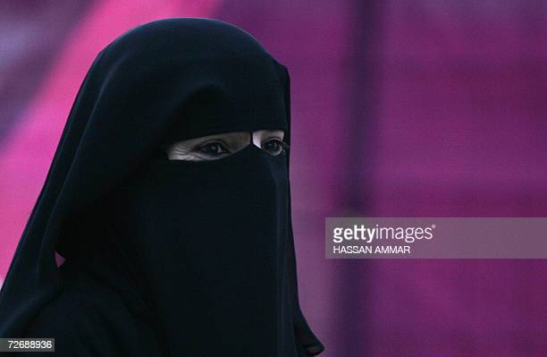 A Qatari woman wearing a traditional veil arrives for the opening ceremony of the 15th Asian Games in Doha 01 December 2006 After years of planning...