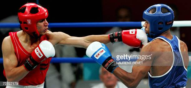 Afghan boxer Mohammad Naim Amini throws a punch to Iraqi Jabar Zuhir in their super lightwight 64kg preliminary bout during the 15th Asian Games in...