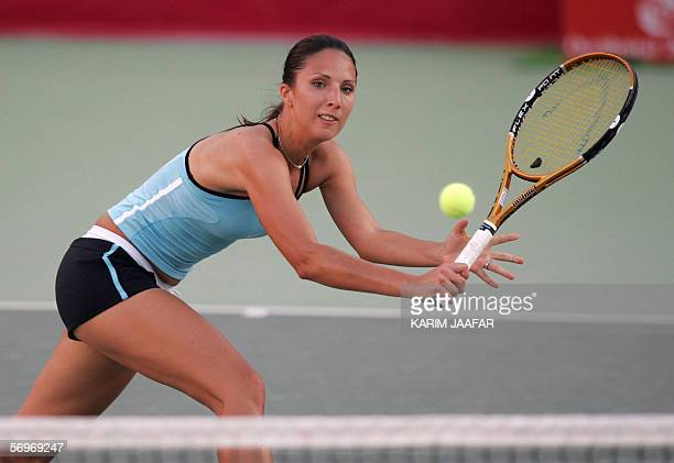 Anastasia Myskina of Russia returns the ball to Ai Sugiyama of Japan during their match at the third day of the WTA Qatar Open tournament in Doha 01...