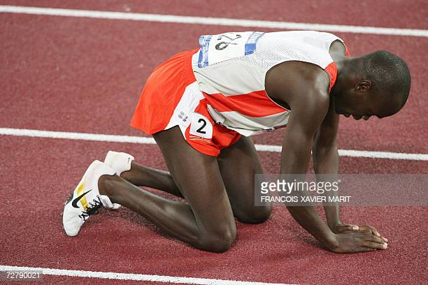 Bahrain's Belall Mansoor Belal kneels on the track after losing in the men's 1500m final by 002 sec on the third day of the athletics competition for...