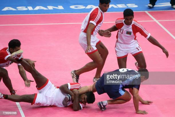 Bangladesh duels India during their Kabaddi round robin at the 15th Asian Games in Doha 02 December 2006 After a glittering opening ceremony the 15th...