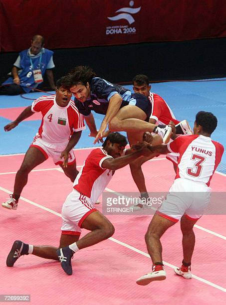 Bangladeshi players surround an Indian opponent during their Kabaddi round robin at the 15th Asian Games in Doha 2006 02 December 2006 in Doha Qatar...