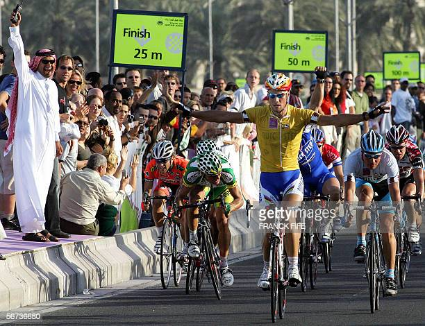 Belgian Tom Boonen celebrates as he crosses the finish line of the last stage of the 5th edition of the Tour of Qatar cycling race between Al...