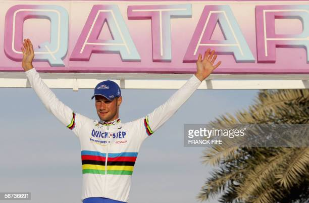 Belgian Tom Boonen celebrates on the podium after winning the 5th edition of the Tour of Qatar cycling race, 03 February 2006. Boonen has been...