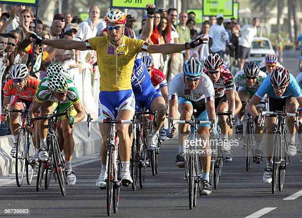 Belgian Tom Boonen followed by Germany's Erik Zabel crosses the finish line of the last stage of the 5th edition of the Tour of Qatar cycling race...