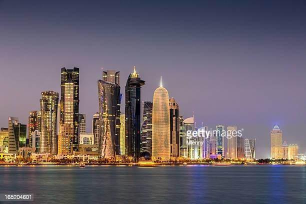 doha qatar by night - doha stock pictures, royalty-free photos & images