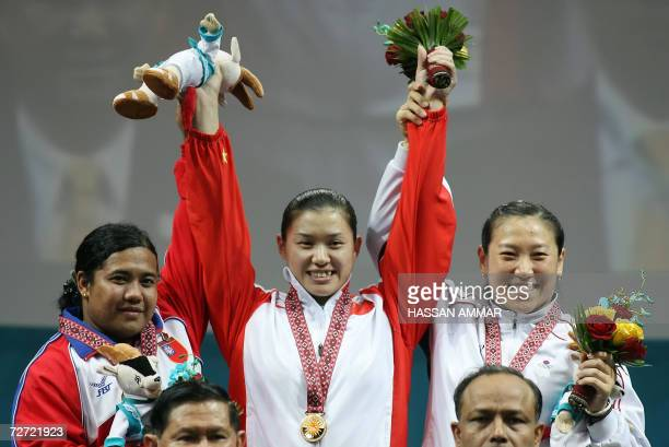 China'S gold winner Cao Lei silver winner Myanmar's Mya Sanda and bronze winner Kim Soon Hee of South Korea stand on the winner's podium at the end...