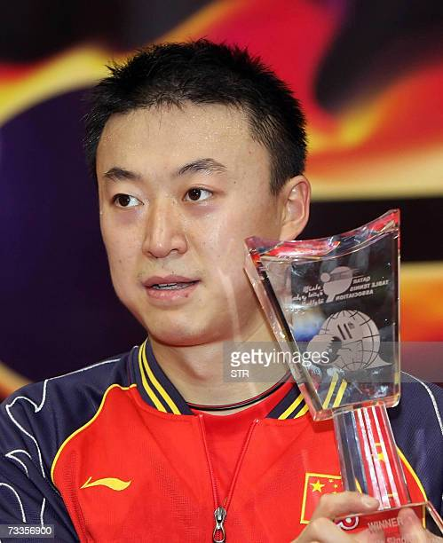 China's Ma Lin holds his trophy after beating his compatriot Wang Liqin in the men's single final table tennis match during the 11th Qatar Open Table...