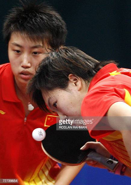 China's table tennis players Guo Yue and Li Xiaoia competes with Taiwan's Huang Yi Hua and Lu Yun Feng in the Women's Double semi-final match at the...