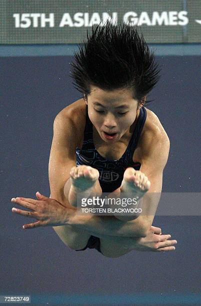 China's Wang Xin executes a backward 2 1/2 sommersault and 2 1/2 twist in pike position during the women's 10m platform diving finals at the 15th...
