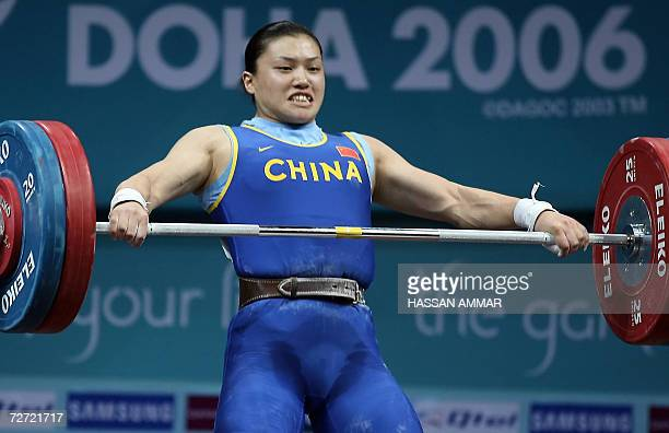 China's world champion Cao Lei competes in the 75kg category in women's weightlifting at the 15th Asian Games in Doha 05 December 2006 Cao set a new...