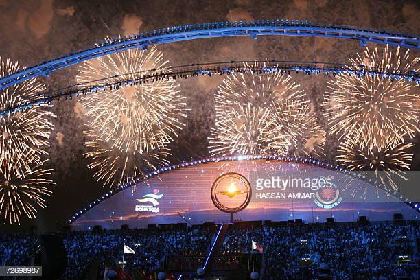 Fireworks explode at the end of the opening ceremony of the 15th Asian Games in Doha, 01 December 2006. Arabian horses, giant caravans and Qatari...