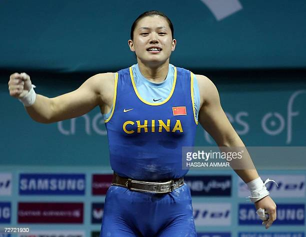 Gold winner of China Cao Lei clenches her first after winning gold in the 75kg category in women's weightlifting at the 15th Asian Games in Doha 05...