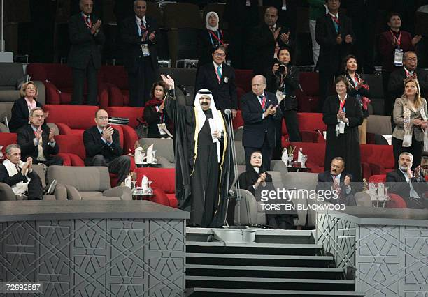His Highness Sheikh Hamad Bin Khalifa al-Thani, the Emir of Qatar, waves from the VIP podium at the 15th Asian Games, next to International Olympic...