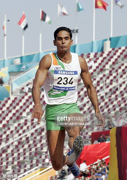 India's P.J. Vinod makes an attempt in the men's decathlon long jump event on the third day of the athletics competition for the 15th Asian Games at...