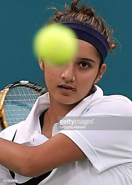 India's tennis player Sania Mirza returns a shot to Murad Inoyatov and Dilyara Saidhodjaeva of Uzbekistan during the Mixed Doubles Round of 16 Tennis...